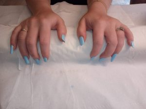 Image of completed acrylic nails that were done by Caroline.