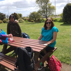 Photo of 2 of the walkers at the Happy feet walking group sitting at a picnic table