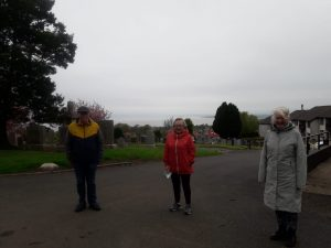 Neil Dalgliesh - Volunteer Walk leader stands with 2 other participants during a walking group