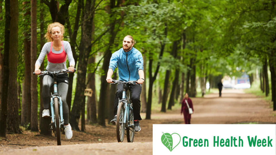 Image of couple cycling in a park. Dundee Green Partnership with text Green Health week in bottom right corner.