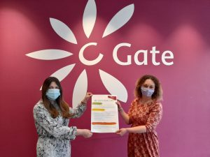 Ashley McIntosh, From Children & Families and co-creator of the leaflet posing with Sarah Boath - Team Leader of Carers Support Team, Dundee Carers Centre. Both are holding a copy of the Young Carer Leaflet that was launched on Young Carers Action Day.